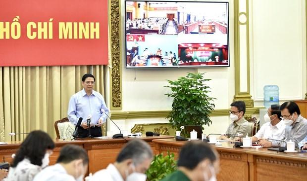 Primer ministro de Vietnam pide continuar apoyando la lucha antiepidemica en Ciudad Ho Chi Minh hinh anh 1