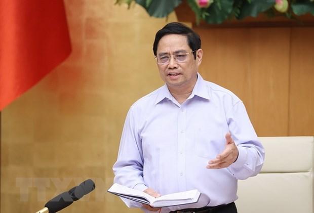 Premier vietnamita destaca objetivo de controlar pronto la pandemia hinh anh 1