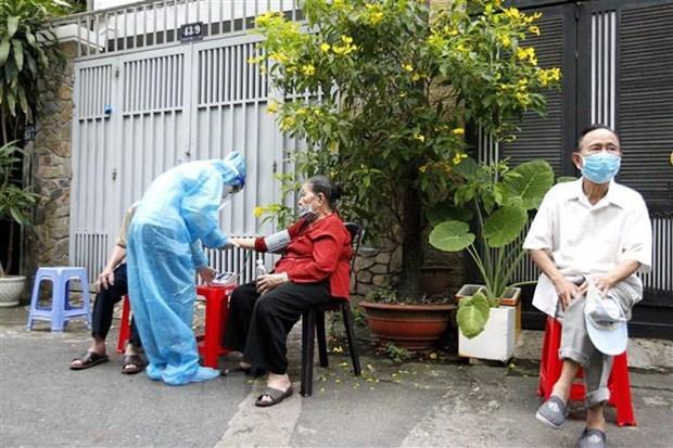 Ciudad Ho Chi Minh proyecta completar vacunacion de personas mayores de 18 anos en 2021 hinh anh 1