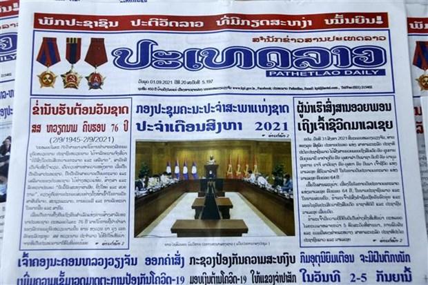 Aprecia prensa laosiana desarrollo socioeconomico de Vietnam hinh anh 1