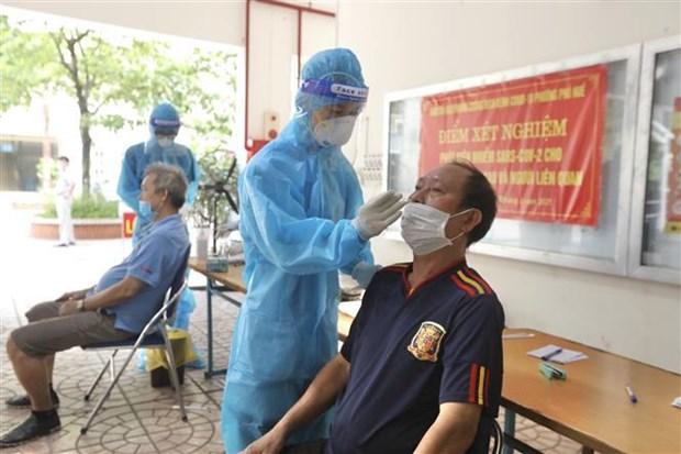 Vietnam y China intercambian experiencias en combate contra el COVID-19 hinh anh 2