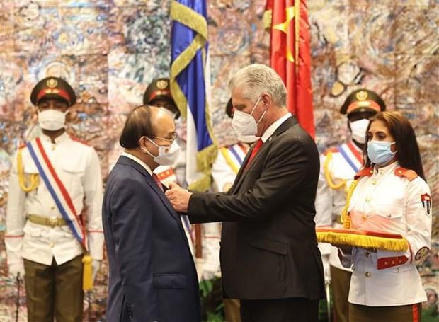 Presidentes de Vietnam y Cuba debaten orientaciones para consolidar lazos bilaterales hinh anh 2