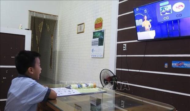 Mas de 20 localidades vietnamitas aplicaran teleclases en ano escolar 2021-2022 hinh anh 2