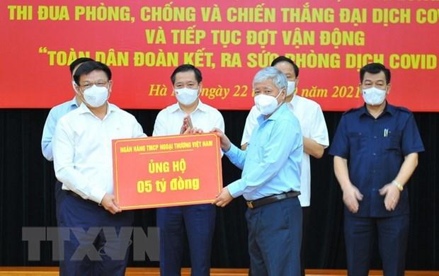 Empresas vietnamitas unen esfuerzos en lucha contra el COVID-19 hinh anh 1