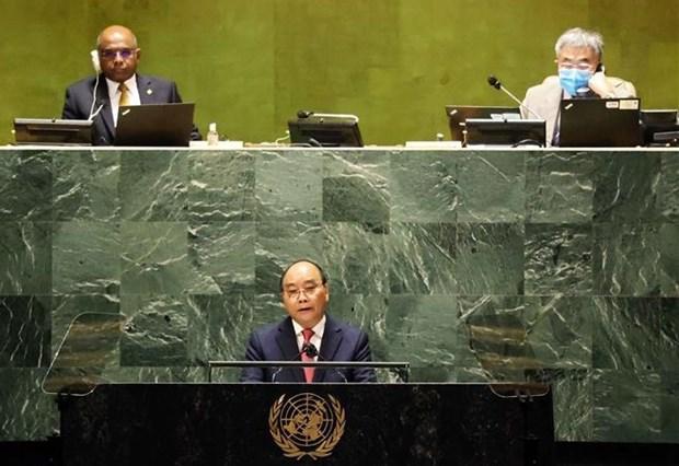 Vietnam comparte con el mundo lucha contra el COVID-19, afirma presidente Xuan Phuc hinh anh 1