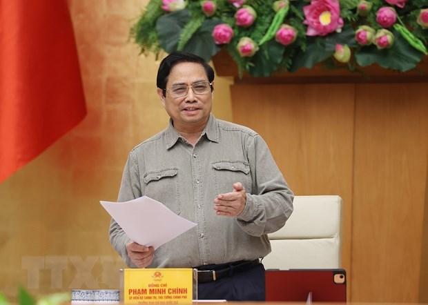 Primer Ministro de Vietnam dialogara con empresas para superar impactos del COVID-19 hinh anh 1
