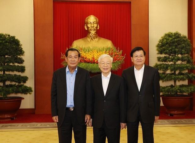 Efectuan Reunion de alto nivel Vietnam-Camboya-Laos hinh anh 1