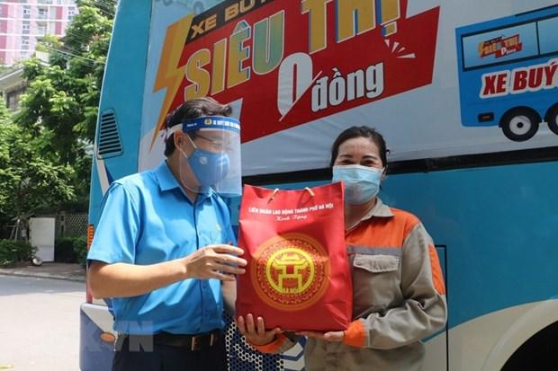 Respaldan a trabajadores y empleadores vietnamitas afectados por el COVID-19 hinh anh 2