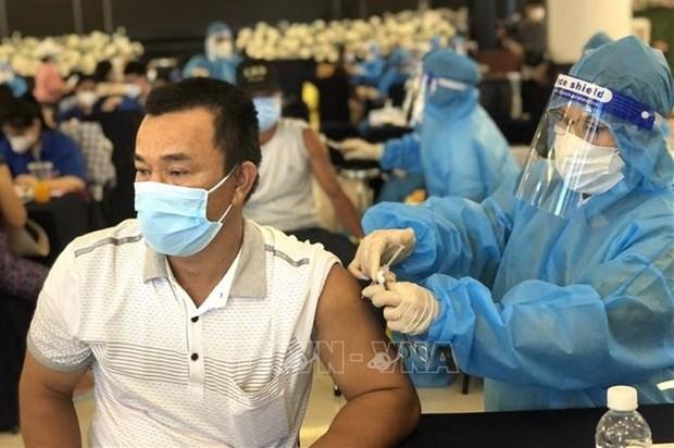 Ministerio de Salud de Vietnam pide acelerar vacunacion contra el COVID-19 hinh anh 1