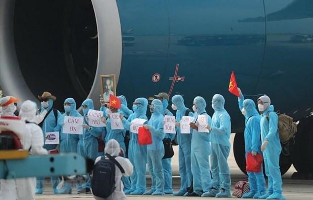 Repatriados mas de tres mil trabajadores vietnamitas en extranjero hinh anh 1